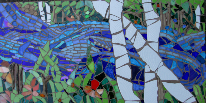 mosaic of birch trees by stream
